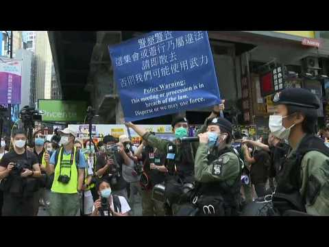 Hong Kong sees heavy police presence to deter protests on China's national day