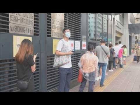 People in Hong Kong queue up to get tested for coronavirus