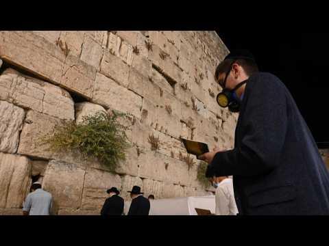 Jewish worshippers pray in Jerusalem's Western Wall
