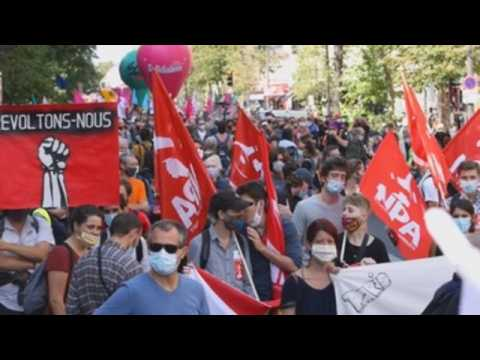 Thousands protest in Paris against government's liberal policies