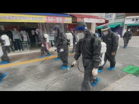 South Korean authorities disinfect streets in Seoul to prevent spread of COVID-19