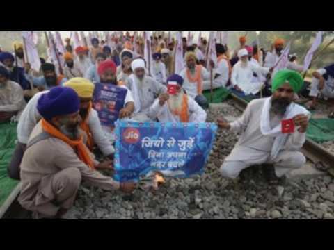 Farmers burn JIO SIM packs during anti-corporations protest in India