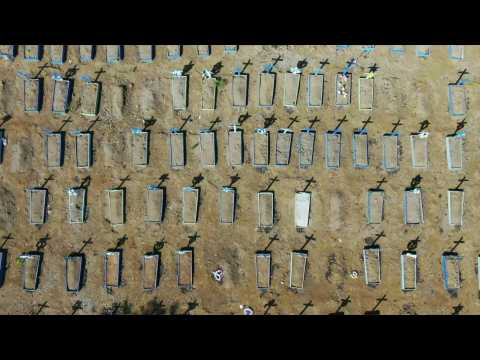 Brazil: aerial images of graves as coronavirus deaths surge past one million