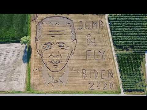 An artist in Italy has carved a huge portrait of Joe Biden into this field