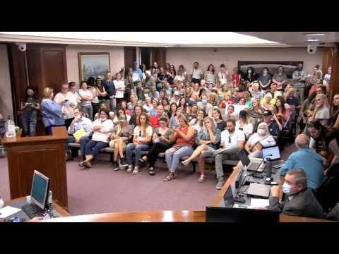 Utah anti-mask protesters crowd room, stop public meeting
