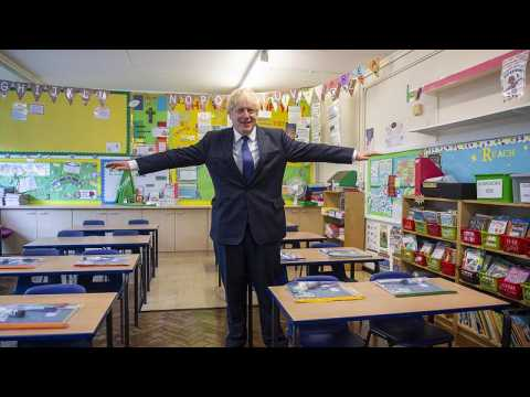 Back to school: Children return to classes in England, Wales and Northern Ireland