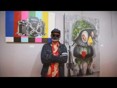 Thai artist opens exhibition featuring political criticism in Bangkok