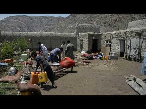 Residents clean up debris after floods ravage Afghan village
