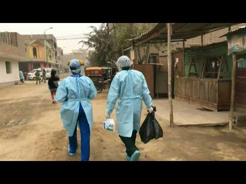 Medical workers test Lima suburb residents for Covid-19