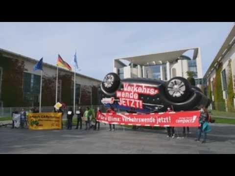 Activists protest against the motor industry in front of Chancellery in Berlin