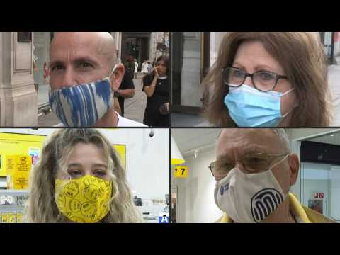 People in England and Austria react as masks become mandatory