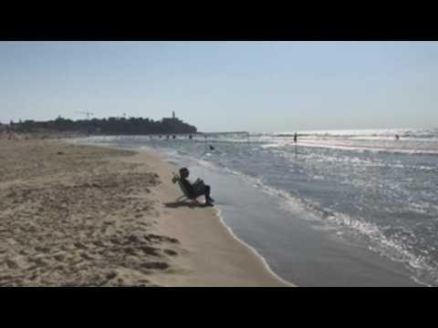 Beach day in Tel Aviv amid more restrictive coronavirus measures