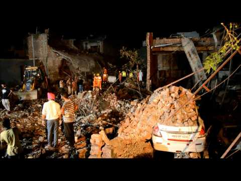 People gather at site of deadly India firework factory blast