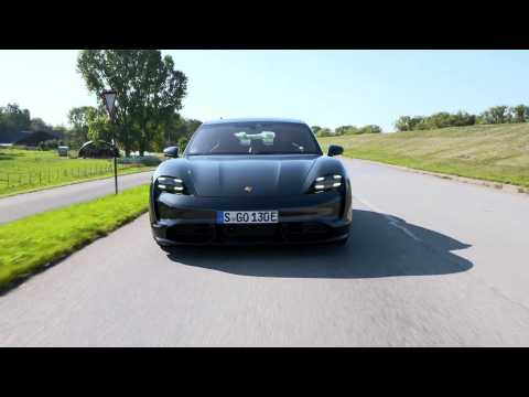 The new Porsche Taycan Turbo in Volcano Grey Metallic Driving Video