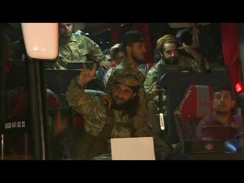 Convoy of Turkish-backed Syrian fighters heads to Syria