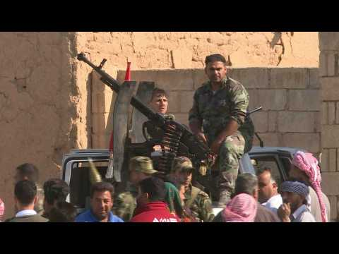 Syrian regime forces in Tall Tamr as they move towards Turkish border