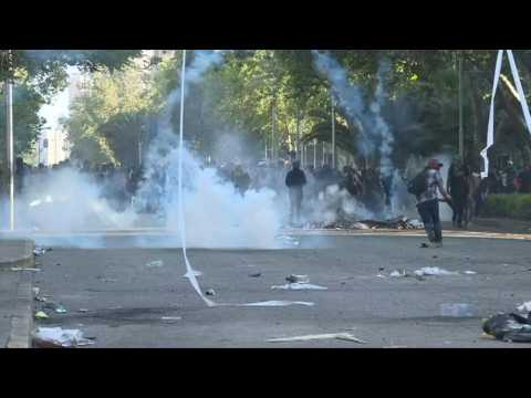 Protesters and police clash in Chile's capital for fourth day in a row