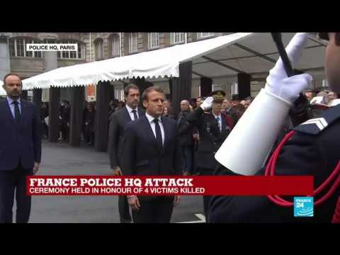 France: French president Emmanuel Macron enters police HQ and pays homage to the victims