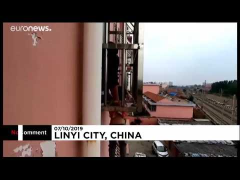 Firefighters rescue boy danging from fourth-floor window in China
