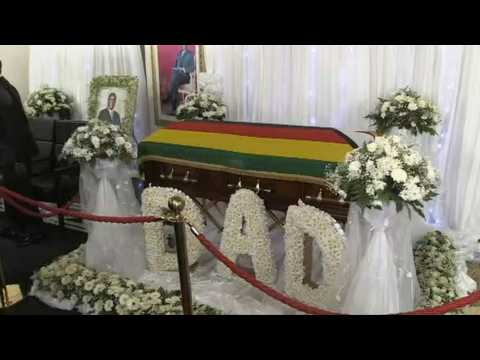Body of ex-president Robert Mugabe lies in state at his private residence