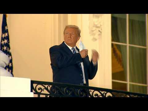 Trump arrives at White House, removes mask immediately