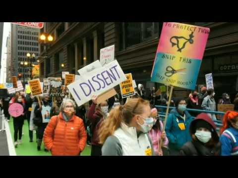 Protesters march in Chicago to protest SCOTUS nominee