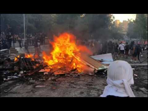 Protesters set barricade on fire during anti-government demonstration