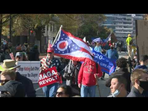 Supporters and opponents of President Trump gather ahead of rally