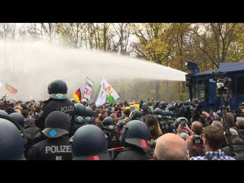 Police fire water cannon to clear Berlin shutdown protest