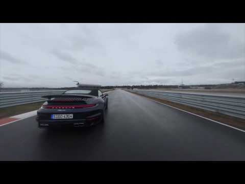 The new Porsche 911 Turbo Cabriolet in Night Blue Driving Video