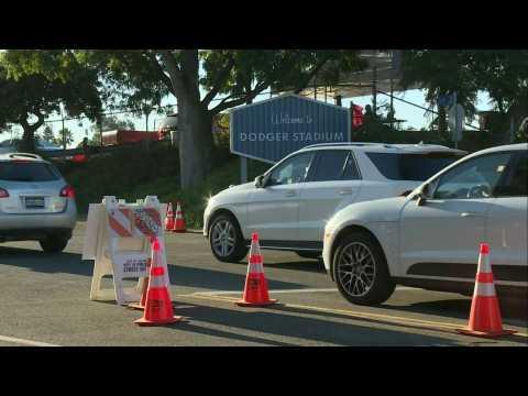 Angelenos flock to Dodger Stadium Covid-19 testing center as virus cases surge
