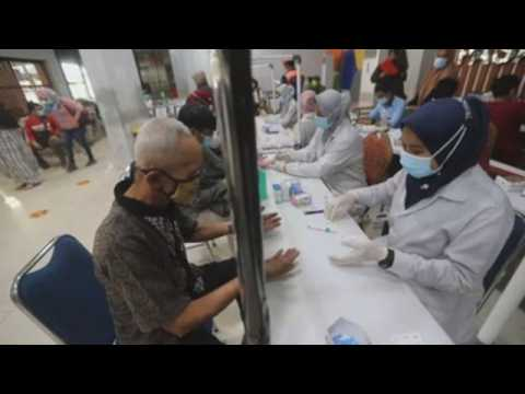 Health authorities carry out COVID-19 tests at a train station in Jakarta