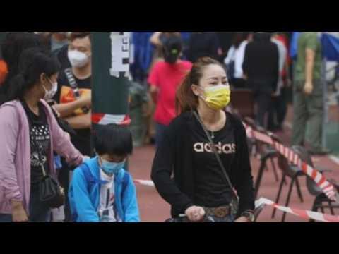 Hong Kong residents queue to get coronavirus test
