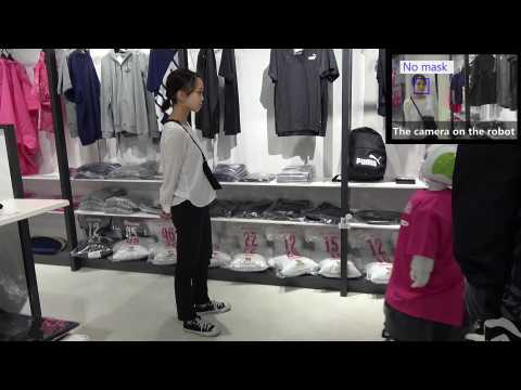 Robot reminds Japan shoppers to wear masks