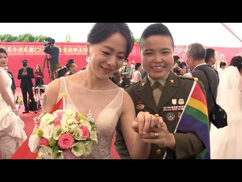 Gay couples tie the knot for first time at Taiwan military wedding