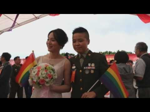 Two LGBT couples get married in Taiwan's military mass wedding