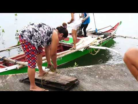 Fishermen prepare ahead of Typhoon Goni devastation in Philippines