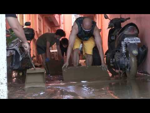 Manila residents clean mud-covered homes after Typhoon Vamco