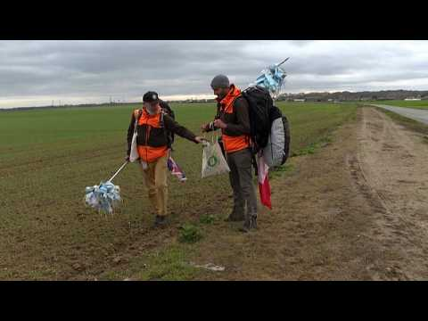 Franco-British duo walk from Marseille to Paris collecting thousands of discarded face masks