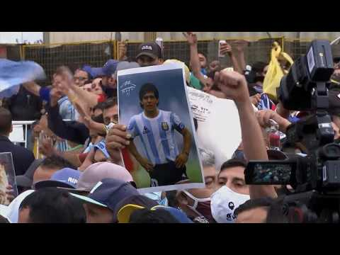 Chaotic scenes as fans scramble to see coffin of football hero Diego Maradona