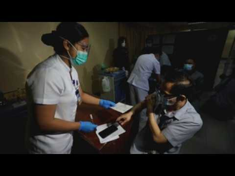 Health workers in Philipines participate in COVID-19 vaccine delivery and administration drill