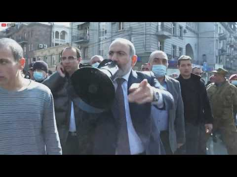 Armenian PM marches through capital with hundreds of supporters