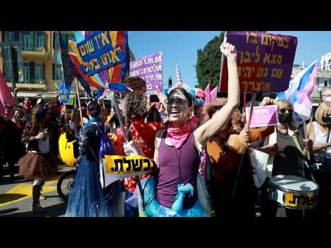 Israelis celebrate Purim with parade amid tighter COVID restrictions