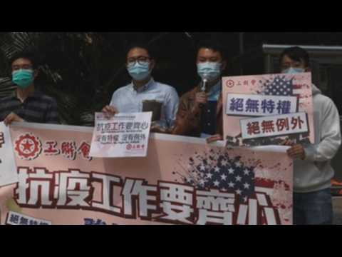 Protest outside US consulate in Hong Kong following positive COVID-19 cases