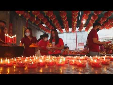 People pray for good fortune on Lunar New Year's Eve in Thailand