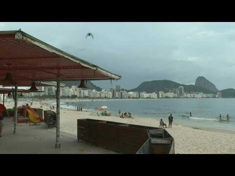 Scene on Rio's Copacabana beach as ban on beach bars, vendors comes into force amid virus surge