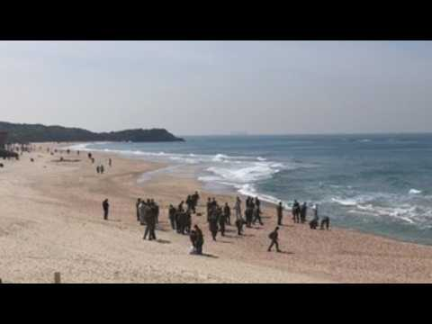 Israel army carries out cleaning works at Tel Aviv beach