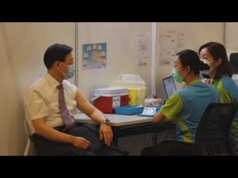 Hong Kong leader, top officials receive COVID-19 vaccines