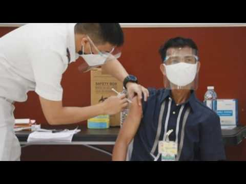 Philippine police vaccinated against COVID-19 on first day of vaccine rollout