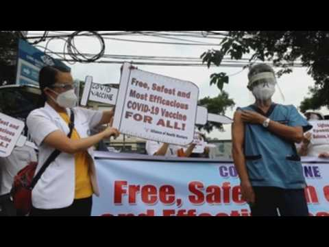 People stage rally to call for free, safe COVID-19 vaccines in Philippines